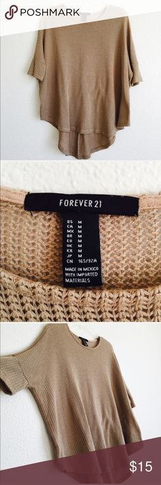 Forever 21 Knit Oversized Top Hi-low. In excellent used condition. Color is tan. Bust measures 26 inches. Front length is 24 inches. Knit style. No flaws. H5. Forever 21 Tops