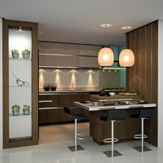 cozinha. Tirando a cristaleira, que  não me agrada nenhum pouco, esta cozinha está bem legal. Gostei das luminárias, que quebram um pouco a linha moderna. E não seis e gosto dos bancos.