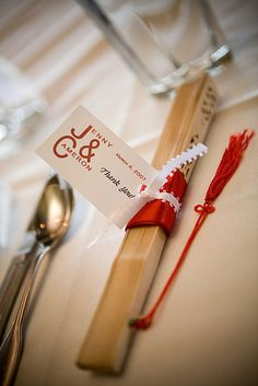 Chinese styled fan as a wedding favor. Monogram favor tag thanking the guests     Check out our awesome wedding ideas at www.CreativeWeddingStyle.com