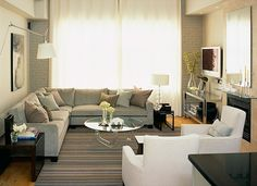 Sectional plus white chairs--perfect for family/living room