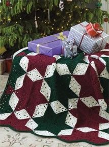 Follow this free crochet pattern to create a christmas star throw using Red Heart Super Saver worsted weight yarn.