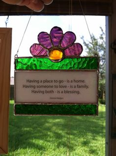 Having a place to go is a home. Having someone to love is a family. Having both is a blessing. How true! Let this pretty suncatcher be a daily