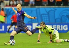 Arjen Robben makes it 5-1.Casillas kisses his boot for good luck.