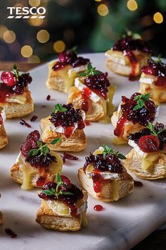 These cute cranberry and Camembert puffs are an easy canapé to try this Christmas. Homemade cranberry sauce is spooned on top of crisp pastry and melting Camembert for an irresistible festive mouthful. Christmas Nibbles, Christmas Canapes, Christmas Buffet, Christmas Party Food, Xmas Food, Christmas Cooking, Christmas Catering, Christmas Desserts, Chrismas Food Ideas