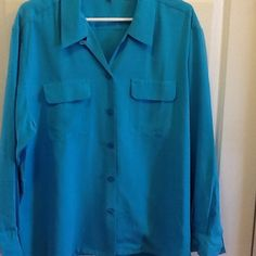 Turquoise 100% Silk Blouse Never worn, 100% silk blouse. 2 breast pockets and buttons down the middle.  Long sleeves with button cuffs. Lady Hathaway Tops Blouses