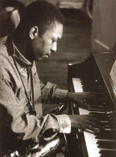 John Coltrane playing piano