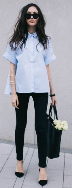 Blue work shirt. Black skinny jeans. Classic pumps. Classic minimalist outfit.  Via | The Fashion Cuisine