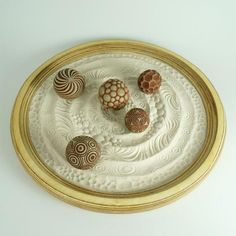 Looking for unique sand play therapy tools? Check out our zen garden with cement patterned balls. Stamp & roll to create fun patterns. Hand made in Portland, OR.