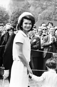 Former First Lady Jacqueline Kennedy with John, Jr. in England in 1965. She was there when Queen Elizabeth II dedicated Great Britain's official memorial to President Kennedy at Runnymede, England. The memorial included several acres of meadowland given in perpetuity from Britain to the U.S., near where King John had signed the Magna Carta in 1215.