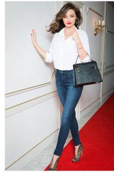 Miranda Kerr wearing Gianvito Rossi Split-Front Ankle Boots and Samantha Thavasa Miranda Chouchou Bag