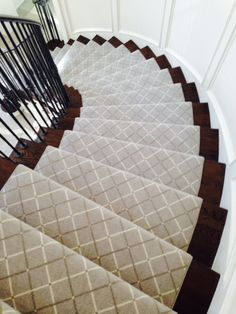 This classic stair runner looks perfect on this traditional curved staircase.