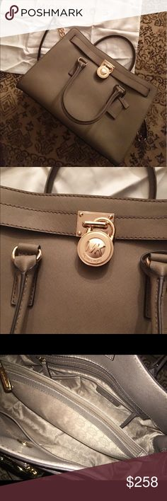 ✨MICHAEL KORS LARGE HAMILTON BAG✨ COLOR DARK DUNE 100% Authentic MICHAEL Michael Kors tote handbag. Saffiano leather. Even prettier in person. Dust bag is included. 14W-13H-6 1/4 D. Chain strap. Gold tone hardware. Lock & key charm. No trades. Bag has only been used few times. Smoke free and pet free home. No marks, no rips, no stains. It's practically new. MSRP is 358+tax. Thanks for looking! 💖 MICHAEL Michael Kors Bags Totes