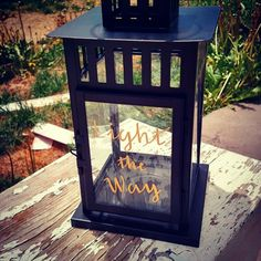 Light the way embossed on a lantern.