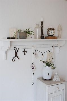 STYLING & SHELVES :: GOOD IDEA--Note the chain w/ clips draped on the hooks of the rack...very clever way to hang cards, notes, pictures, etc.