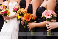 Black bridesmaids dresses with colorful flowers
