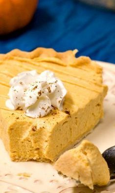Pumpkin Mousse Pie - light and creamy pumpkin pie thats a perfect finish to a Thanksgiving dinner. This no-bake pie is made in under half an hour and can be made ahead of time. The time saving dessert you need for the holidays! No Bake Pumpkin Cheesecake, No Bake Pumpkin Pie, Baked Pumpkin, Pumpkin Dessert, Pumpkin Recipes, Pie Recipes, Dessert Recipes, Pumpkin Pies, Creamy Pumpkin Pie Recipe
