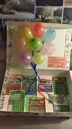 A box filled with lottery tickets and pop up balloons is a lucky gift idea for a 50th birthday. See more 50th birthday gift ideas and party ideas at www.one-stop-party-ideas.com