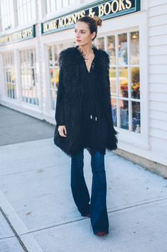 Faux Fur Vest and Flare Jeans
