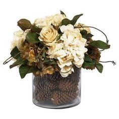 """Bring rustic style to your tablescape or mantel with this lovely arrangement, brimming with faux hydrangeas and pinecones.    Product: Faux floral arrangementConstruction Material: Glass and art silkColor: White and greenDimensions: 14"""" H x 14"""" Diameter"""