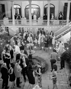 Both the cocktail hour and the reception occurred in the house and the courtyard, where guests could leisurely enjoy food and drinks. The courtyard remained well-lit with hanging café lights so that guests could enjoy bourbon, the oyster bar, and dancing through the night.