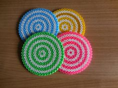 set of 4 colorful party coasters, green, fluor pink, yellow and blue. Round coaster, gin gifts