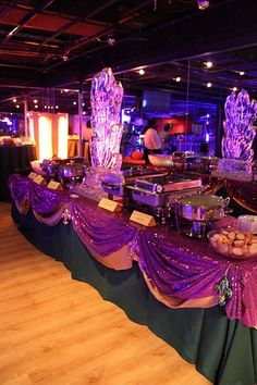 The swags in Mardi colors for the food table and round tables.