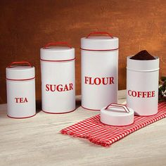 Vintage Baked Enamel Kitchen Canisters. Food safe old-fashioned baked enamel canisters; tea, sugar, flour and coffee. Tight-fitting lids but are not air-tight.