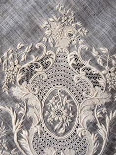 white with lace embroidery (baroque) in contrast to white paint cracked on surface