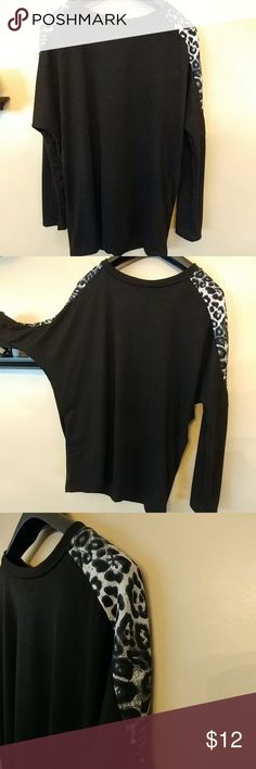 Long sleeve top with leopard print accents Edgy dohlman long sleeve top with Leopard print accents on front and back. This fits like a large. Tops Blouses