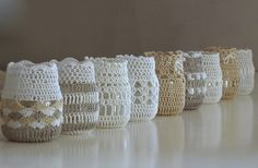 crochet jars - love the different patterns