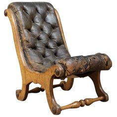 A low leather x frame chair  | From a unique collection of antique and modern chairs at https://www.1stdibs.com/furniture/seating/chairs/