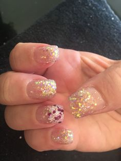 Gold sparkle nails with a feature nail