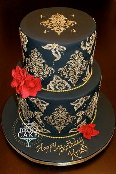 Black two tier cake with gold damask