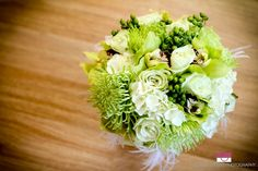 Flowers in green/ cream- with feathers- gorgeous