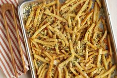 Garlic-Parmesan Fries - yum!  Here's a restaurant-quality appetizer with a cheesy herb topping to get your gathering off to a rousing start.