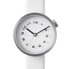 Minimal and Classic Style // I love the new modern white on white Draftsman 01 watch by Nendo. www.dezeenwatchstore.com