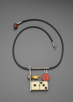Mixed Media, Ramona Solberg, Red Two, 1998, dimensions  38.1 x 22.9 x 1.3 cm (15 x 9 x 1/2 in.), (pendant): 9.5 x 8 x 1.3 cm (3 3/4 x 3 1/8 x 1/2 in.), Silver, antique dominoes, antique carved hand, red gambling chip, cinnabar bead cut in half, rubber cord