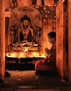 Monk praying at Bodh Gaya, India.