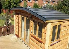 Flat roof garden shed and shedworking: new look garden office roof.