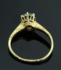 i buy so many old rings because of a crown like setting...i guess i like this sort of thing ;)