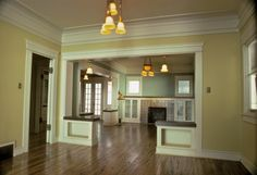 Front and back parlors with built-ins, tile fireplace, and oak floors- lights custom built by Isabel Thompson.