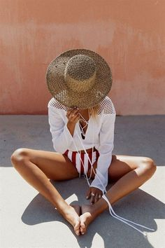 Hat and striped swim suit