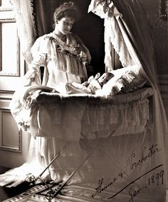 Almina the 5th Countess of Carnarvon stands at the crib of her son, Henry George, who would go on to become the 6th Earl of Carnarvon
