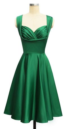I have this is red and it's a beautiful dress...might have to have it green too ;-)!