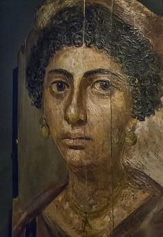 (c. 100-105 CE) Encaustic Mummy Portrait of a Woman with Earrings