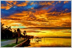 Sunset at the mouth of the Manatee River,  looking out to west to the Gulf, along Riverside Drive, Bradenton, Florida.