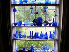 Cobalt blue....love blue glass and I will have a window like this one day in my house