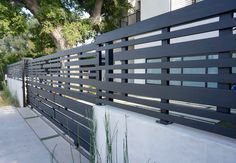 Modern fence and gate. Clear redwood and steel combination.  Los Angeles, Ca