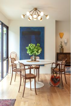 Thonet Chairs, Saarinen Tulip Table, Cool Light Fixture