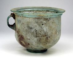 "Large Cup or Stein. Roman Asia Minor, late 1st to 3rd century AD. Height: 4-7/8""; Width: 6-3/4"". Nicely crafted in aqua blue glass, $460"